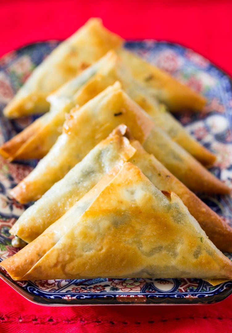 A plate of baked spinach and feta cheese samosa