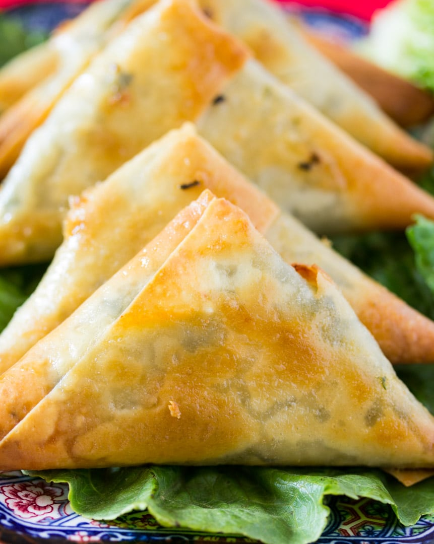 Close up of baked spinach and feta cheese samosa