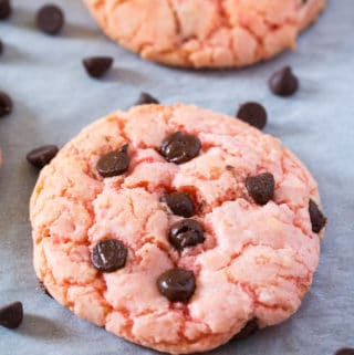 Close up of a Strawberry Cake Mix Cookie with chocolate chips.