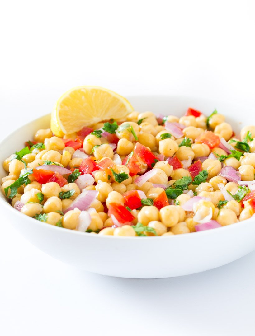 chana chaat in a white bowl, placed on a plain white background