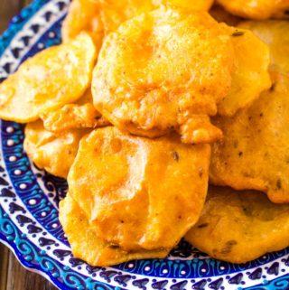crispy aloo pakora served on blue turkish plate