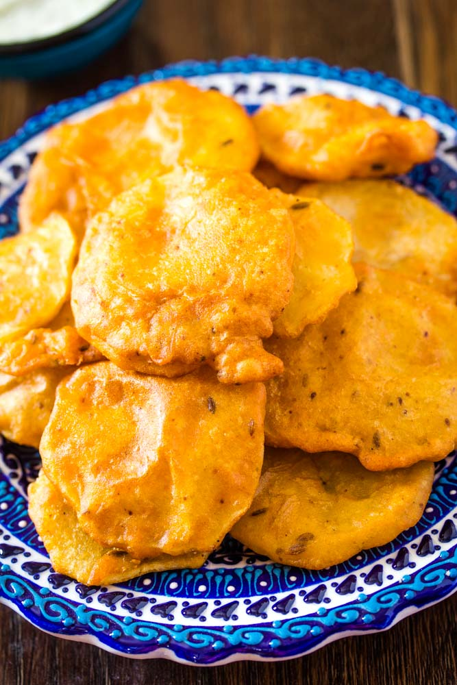Closeup of crispy aloo pakora on plate