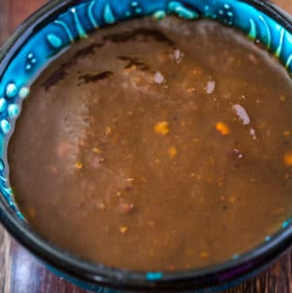 Close up shot of tamarind sauce in a blue bowl