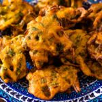 closeup of pakistani mixed pakora vegetable on blue plate