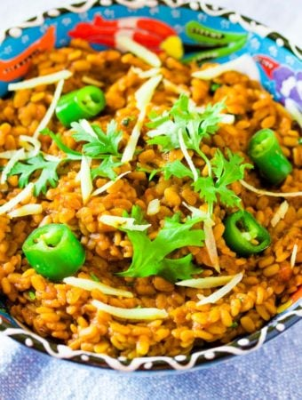 Daal Mash Served in a blue bowl topped with green chillies and coriander