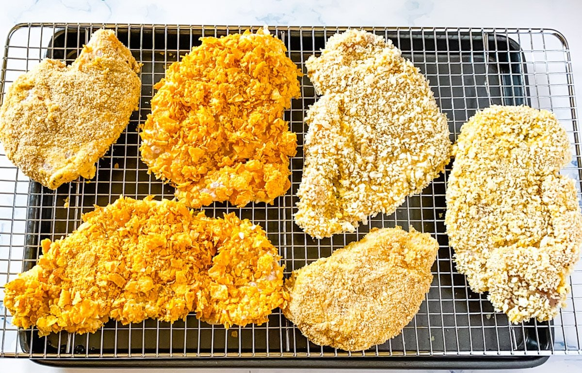 breaded chicken cutlets placed on a baking rack.
